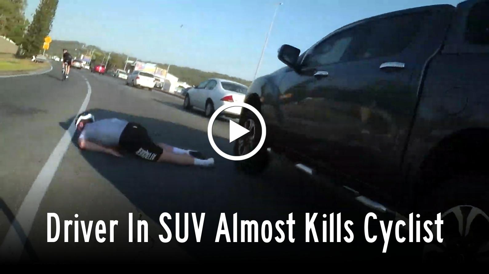 Driver in SUV Almost Kills Cyclist